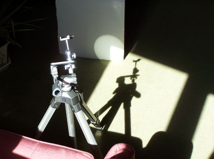 The camera tripod. Behind, the Sun's image on grey paper.